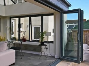 Bifold doors in black aluminium fitted into an extension